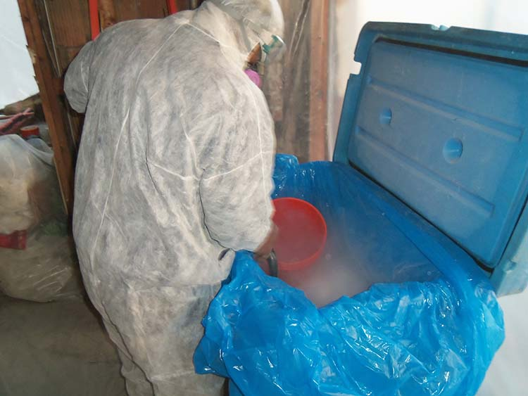Image of a One Stop Environmental employee preparing to perform dry ice blasting.