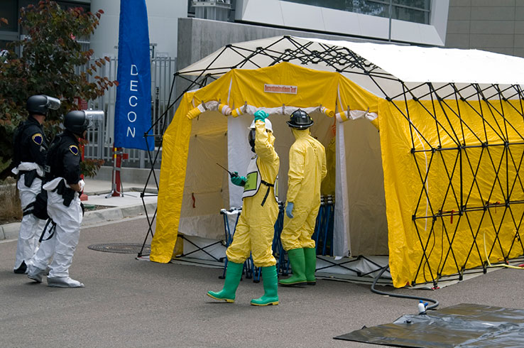 Image of employees preparing to perform a spill cleanup
