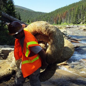 Image of a One Stop Environmental technician working a erosion control and stream bank restoration project for the US Department of Interior.