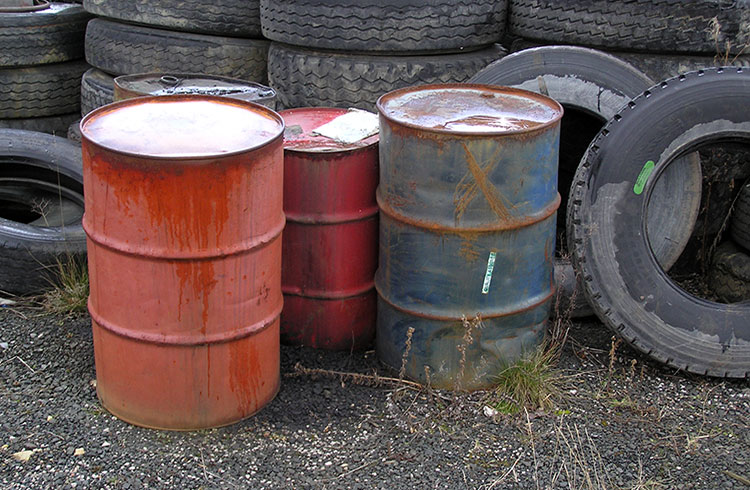 Image of unidentified drums. One Stop offers waste minimization services to reduce the amount of waste sent to landfills.