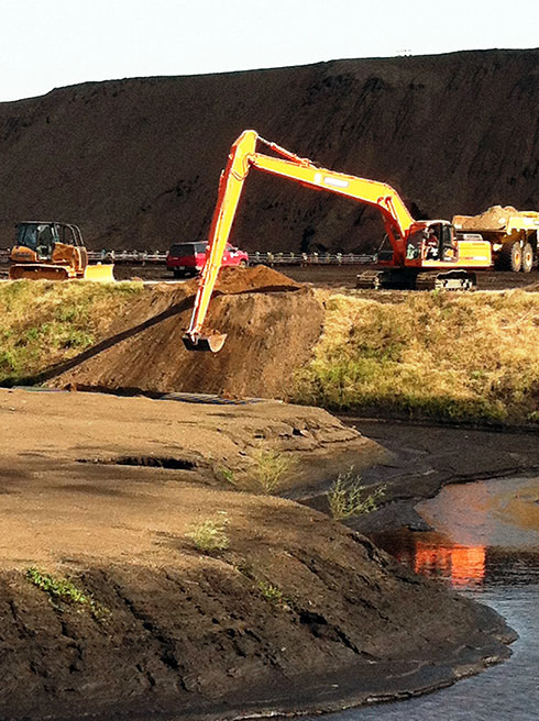 Image of One Stop Environmental operators performing ash pond remediation for Plant Miller.