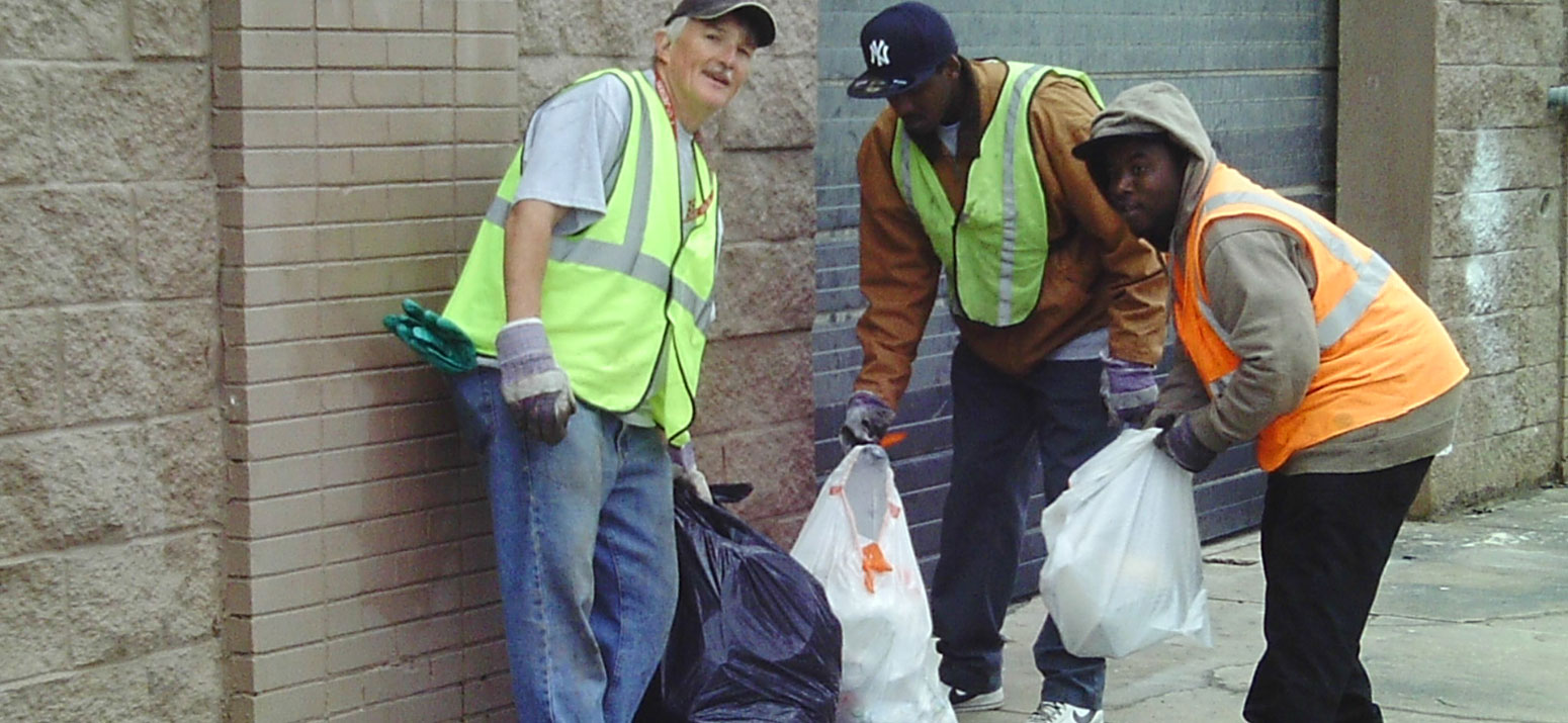 Image of One Stop Environmental employees picking up trash in Woodlawn