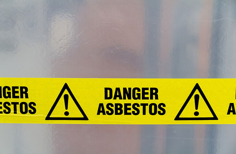Image of asbestos warning tape. One Stop Environmental performs asbestos surveys for commercial properties.
