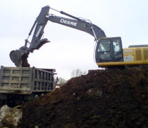 Image of a One Stop Environmental operator performing soil remediation at the former Shredders Facility.